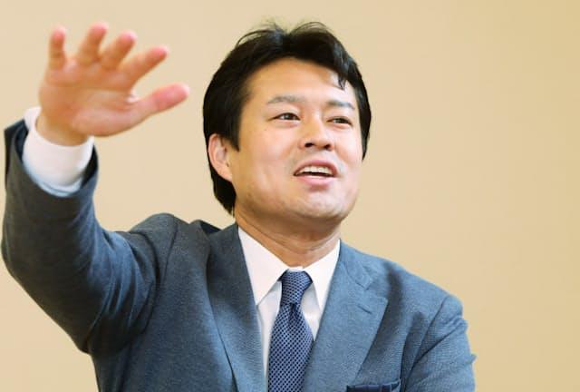 法政大学キャリアデザイン学部の田中教授