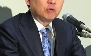 26日、東証で決算会見したマネックスGの松本大社長