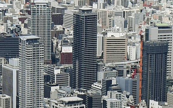 不動産賃貸取引は紙の書面に基づく説明が前提だ(タワーマンションが林立する大阪市内)