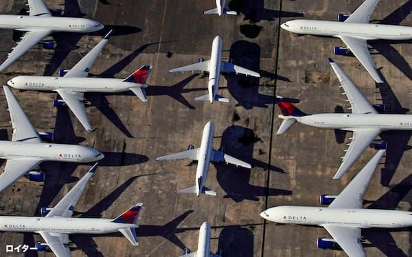 新型コロナウイルスの感染拡大防止のため世界中で航空便の運航停止が相次ぎ、今年の温暖化ガス排出量は減少するが、「パリ協定」の目標達成には遠く及ばない=ロイター