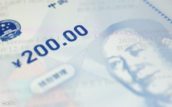 デジタル人民元はデジタル通貨の発行を検討する多くの国々の通貨当局から関心を集めている=ロイター