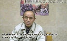 動画投稿サイトで「市民は兵糧攻めの状態」と訴える福島県南相馬市の桜井勝延市長=共同