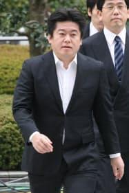 2007年3月、判決公判のため東京地裁に入る堀江貴文被告