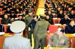 9日、北朝鮮の朝鮮中央テレビが放映した、8日の党政治局拡大会議の場から連行される張成沢氏=聯合・共同