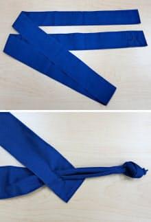 写真1 タスキの端をもう一方の端の穴に通して輪にする。抜けないように固結びでコブを作る