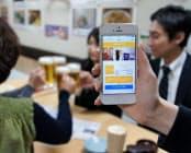 居酒屋などでアプリを起動すれば生ビールが1杯分無料になる(東京・有楽町の美味千成)