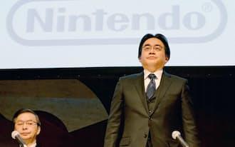 任天堂の岩田聡社長はスマホゲームへの進出に否定的だ(2014年1月の経営方針説明会)=共同