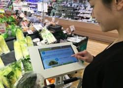 ショッピングカートのタブレットにクーポンやお薦めレシピが表示される