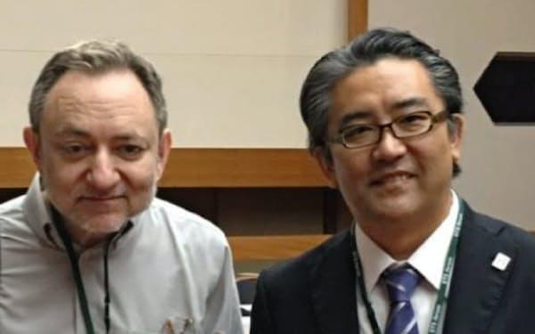 ノーベル賞学者のファイアー博士(左)と「科学技術と人類の未来に関する国際フォーラム」にて