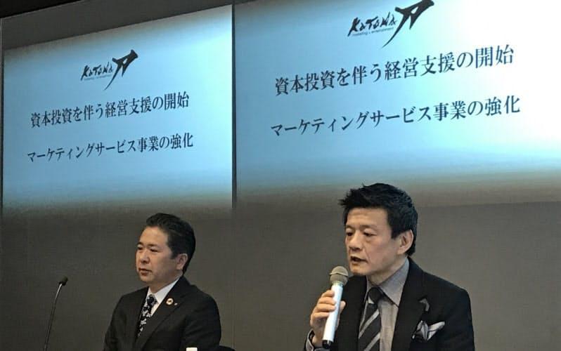 創業2年で大和証券グループ本社と資本業務提携した(右が森岡氏)