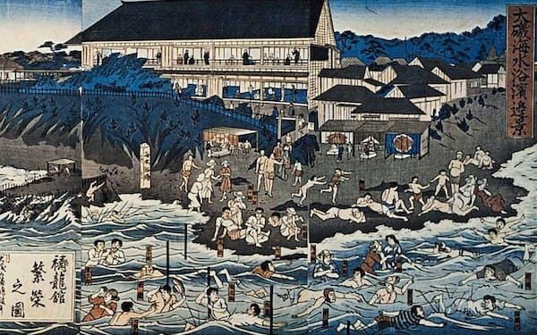 医療目的で始まった海水浴。当初は棒につかまって波を浴びた=大磯町郷土資料館提供