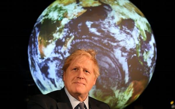 COP26は11月に英グラスゴーで開催される(関連会合に出席したジョンソン英首相)=ロイター