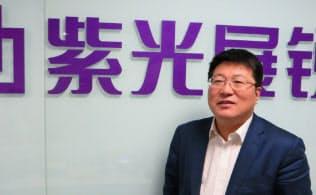 紫光集団の趙董事長は「中国の飢えた虎」の異名をとる
