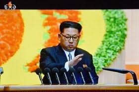 7日、北朝鮮の朝鮮中央テレビが放映した、朝鮮労働党大会2日目に出席した金正恩第1書記=共同
