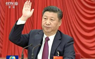 中国共産党の第18期中央委員会第6回総会で「核心」に格上げされた習近平総書記(10月27日、中国中央テレビの映像)=共同