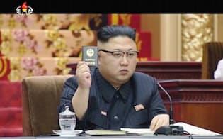 北朝鮮の朝鮮中央テレビが11日放映した、平壌で行われた最高人民会議に出席する金正恩朝鮮労働党委員長の映像(共同)