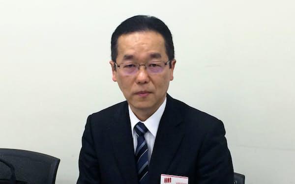 決算を発表する東宝の太古伸幸常務(14日、東証)