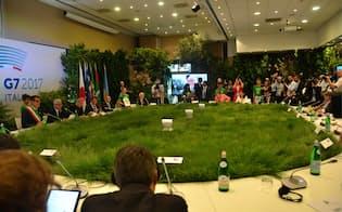 パリ協定を巡る米国と6カ国の溝は埋まる見込みがない(11日、伊ボローニャ)=代表撮影