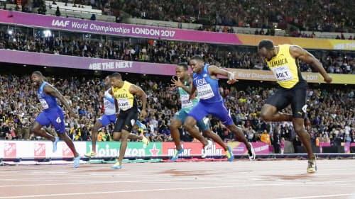 男子100メートル決勝で3位に終わったボルト(右端)=共同