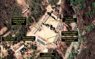 5月18日に撮影された、北朝鮮・豊渓里にある核実験場の衛星写真。丸で囲った部分に、新たに建設が始まったとみられる建物が写っている(デジタルグローブ/38ノース提供)=ゲッティ・共同