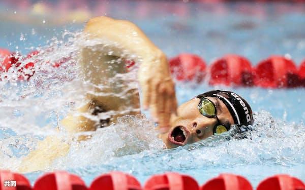 男子100メートルバタフライ(運動機能障害S9)決勝 1分2秒33の日本新で優勝した山田拓朗(19日、千葉県国際総合水泳場)=共同