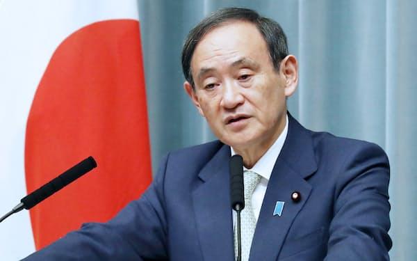 官房長官の菅義偉氏。「前に出ない政治手法」が実力者に押し上げたとされる
