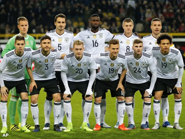 FILE - In this Wednesday, March 22, 2017 filer, the German team pose for a team photo prior to the friendly soccer match between Germany and England in Dortmund, Germany. Players are, back row from left, Germany's goalkeeper Marc-Andre ter Stegen, Mats Hummels, Antonio Ruediger, Toni Kroos and Germany's Lukas Podolski and, front row from left, Julian Weigl, Jonas Hector, Julian Brandt, Joshua Kimmich, Timo Werner and Leroy Sane (AP Photo/Frank Augstein, File)