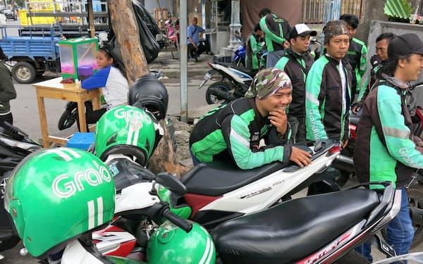 グラブバイクの運転手(1月、ジャカルタ)