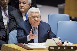 20日、国連安全保障理事会で演説するパレスチナ自治政府のアッバス議長(ニューヨーク)=国連提供