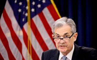 3月21日、米連邦公開市場委員会(FOMC)後に記者会見するパウエルFRB議長=ロイター