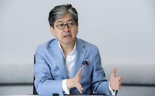 仮想通貨事業を取り込み「金融を再定義する」と語る松本大・社長CEO(写真:的野弘路)