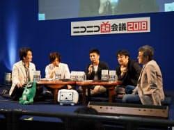 サイバーエージェントの藤田晋社長(中央)やテレビ局のプロデューサーらが放送とネットの融合について議論した(29日、幕張メッセ)