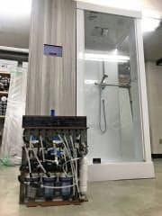 現行の浄化装置とシャワーブース