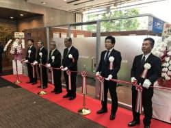 FFG証券熊本支店の開設式典(14日、熊本市の熊本銀行本店)
