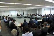 「CO2削減量」をブロックチェーンで売買する実証実験を始める(25日、都内で環境省が開いた協議会)