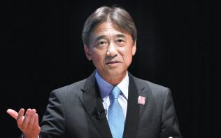 講演するNTTドコモの吉沢和弘社長(4日午後、東京・大手町)