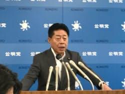 記者会見する公明党の北側一雄中央幹事会会長(21日、東京・新宿)