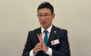 記者会見するキャンディルの林晃生社長(5日午後、東証)