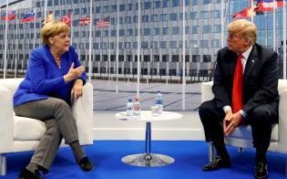 メルケル独首相(左)とトランプ米大統領=ロイター
