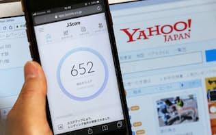ヤフーは「Jスコア」(東京・港)にデータ提供し、個人の信用力を点数化する