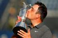 全英オープンゴルフでメジャー初制覇を果たしたフランチェスコ・モリナリ(22日、カーヌスティ・リンクス)=ロイター