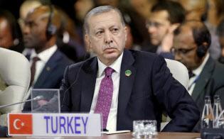 トルコ経済の苦境が深まっている(写真はエルドアン大統領)=ロイター