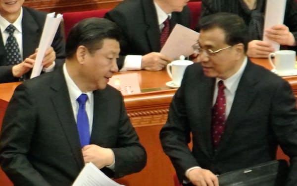 少しづつ地歩を固める習近平国家主席と、政府をあずかる李克強首相(北京の人民大会堂で)