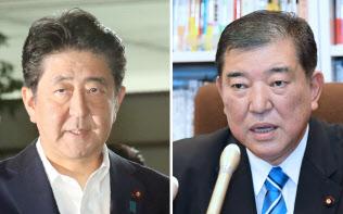 首相官邸に入る安倍首相(写真左)と記者の質問に答える自民党の石破元幹事長(7日午前)