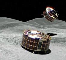 小惑星「りゅうぐう」への着陸に成功した2探査ロボット。跳びはねながら移動する。=想像図、JAXA提供