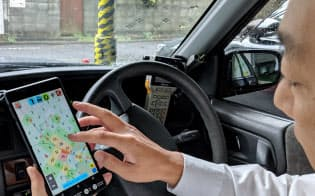 「AIタクシー」は乗客の需要予想を数字や色で表して運転手を支援(東京都中野区)