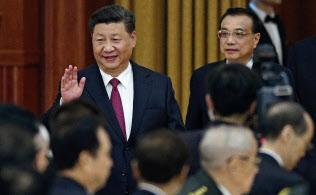 習近平国家主席は中国共産党の指導と企業統治の「融入」を訴える=AP