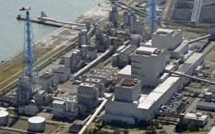 北海道電力には停電の復旧費用がのしかかる(北海道厚真町の苫東厚真火力発電所)=共同
