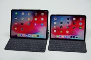 米アップルが発表した「iPadプロ」。11インチと12.9インチの2モデルがある。ホームボタンがなくなり、オプションのキーボードを装着すると一見ノートパソコンのように見える