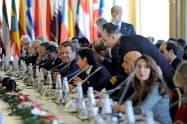 13日、イタリア南部シチリア島パレルモで開いたリビア和平会議=ロイター